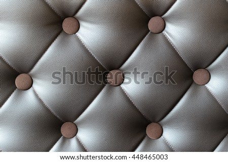 Close up on dark brown leather sofa texture background