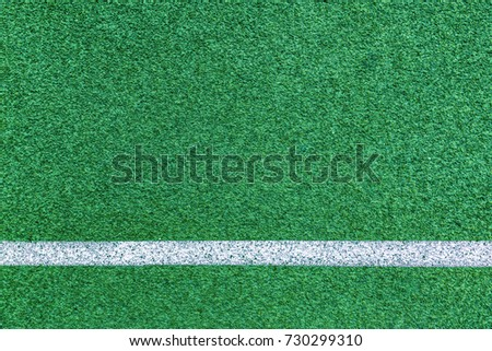 close up on detail of Green line field and white line, sport background.