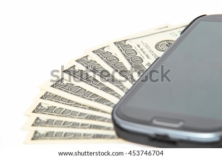 Close up on dollar bills, Smartphone lying on the United States dollars, isolated on a white background