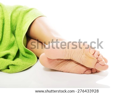 Close up on female bare feet. - stock photo