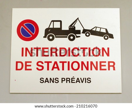 Close up on french vehicles towing sign on a wall - stock photo