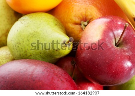 Close up on fruit composition- apples, peaches and banana.