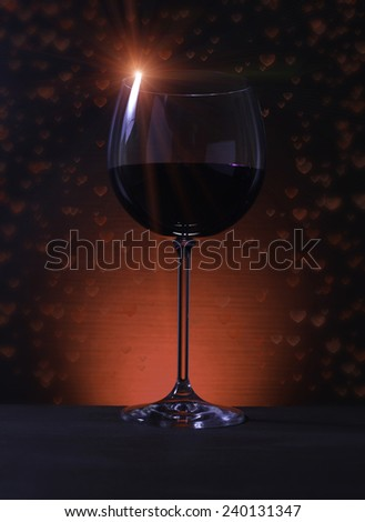 Close up on Glass of Red Wine with Lights Background with hearts