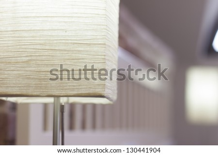 Close up on lamp in hotel room - stock photo