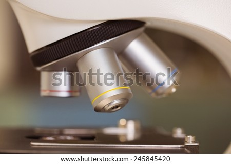 Close up on microscope in laboratory at the university - stock photo
