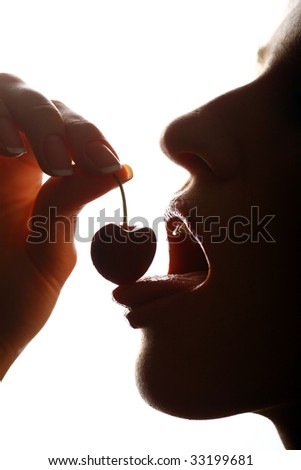 close up on of a sensual girl playing with her mouth with a cherry - stock photo