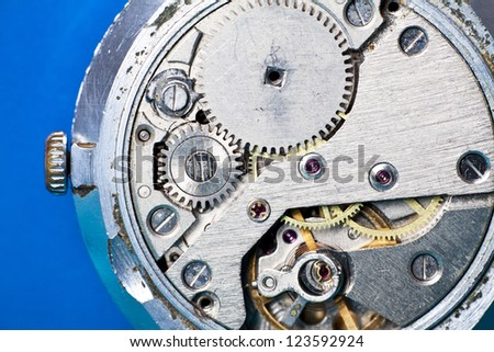 Close-up on old clock mechanism - stock photo