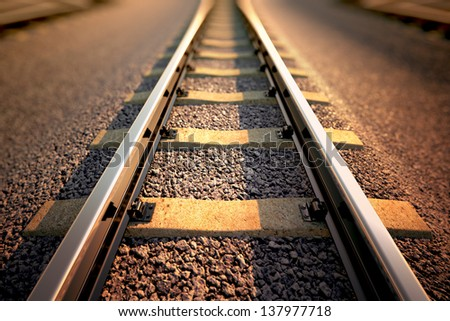 Close up on part of railroad track from top view. - stock photo