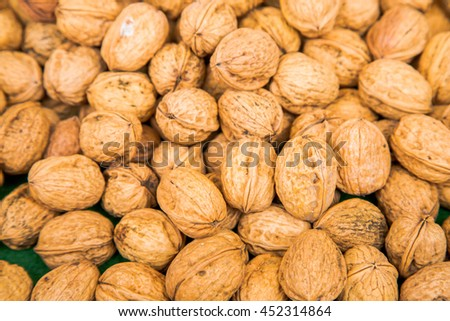 Close up on Pile of walnuts in their shells