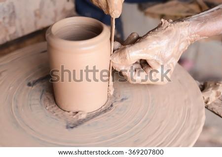 Close-up on potter making a ceramics jar near the town of Ban Tha Hai in Ubonratchathani, Thailand - stock photo