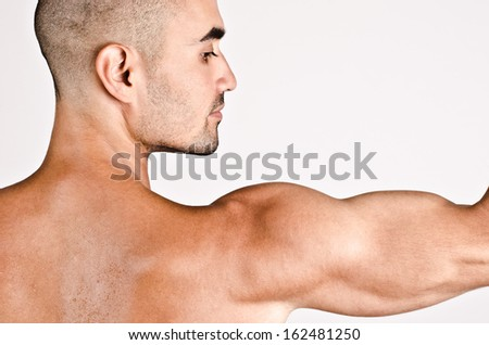 Close up on profile of a man and the arm with the shoulder and biceps. - stock photo