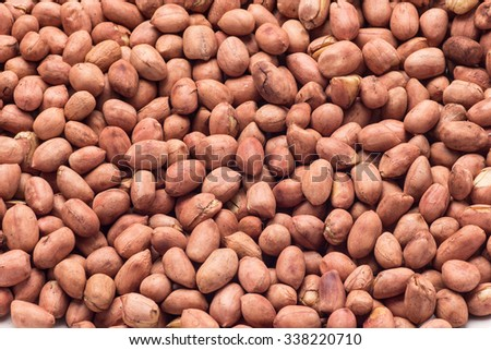 Close-up on raw peanuts background