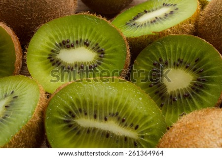 Close up on ripe half kiwi fruits on a grey plate. Healthy eating. - stock photo