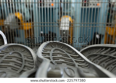 Close-up on rubber soles in workshop - stock photo