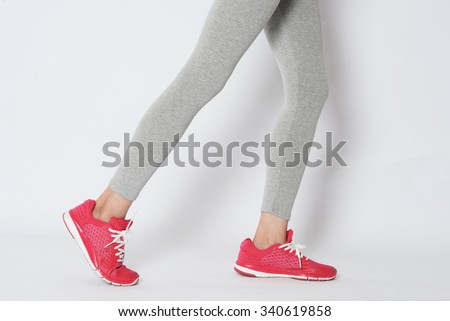 Close up on running legs and shoes in the action - stock photo