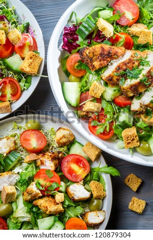 Close-up on salad with croutons - stock photo