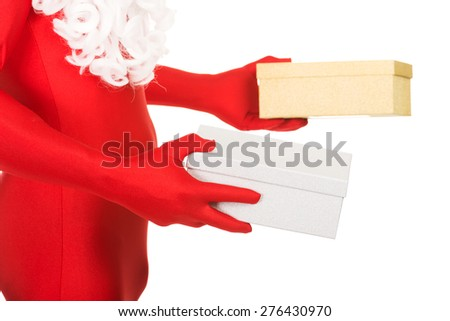 Close up on santa hands holding gifts. - stock photo