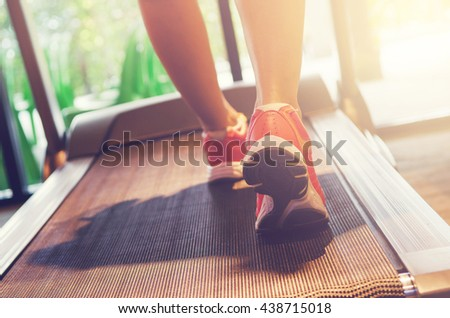 Close up on shoe athlete, Woman running in a gym on a treadmill concept for exercising and sunlight effect, fitness and healthy lifestyle - stock photo