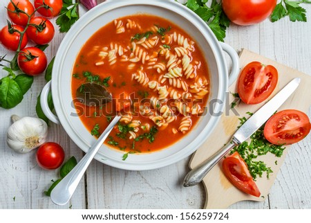 Close-up on sliced �¢??�¢??fresh tomatoes and tomato soup made �¢??�¢??of them - stock photo