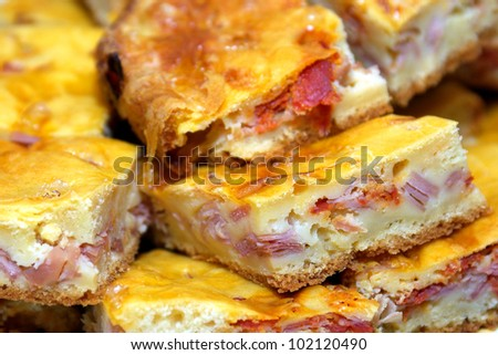 Close-up on slices of delicious meat and ham cake - stock photo
