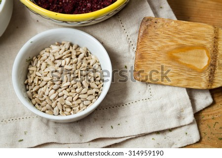 Close-up on small bowl of sunflower seeds. - stock photo
