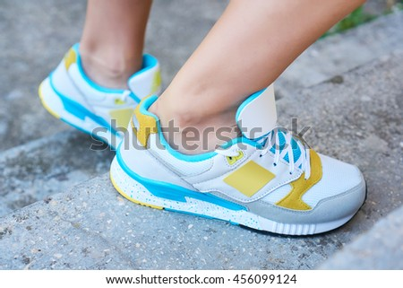 Close up on sports shoes, girl on the stairs moving - stock photo