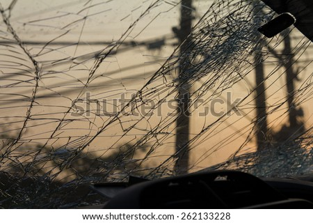 Close up on the inside of the windshield to crack due to an accident, collision dawn. - stock photo