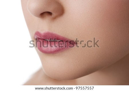 close up on the lips of a natural beauty model on white