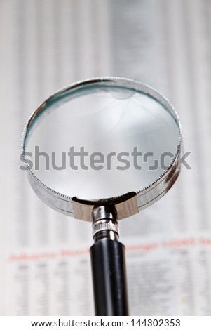 close up on the magnifier glass on financial report