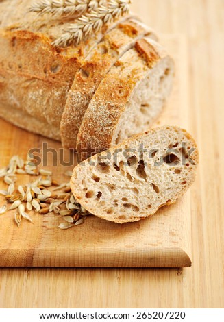 Close-up on traditional bread on wooden board - stock photo