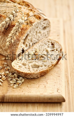 Close-up on traditional bread on wooden board