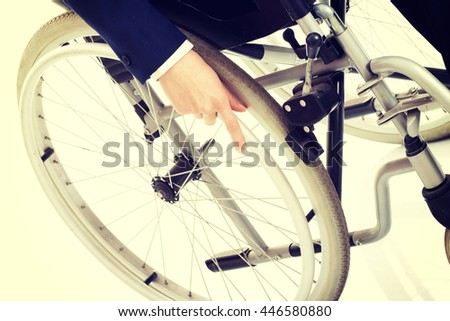 Close up on woman's hand on wheelchair. - stock photo