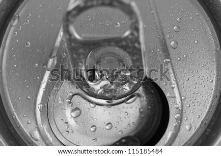 Close-Up open aluminum can with water drops - stock photo