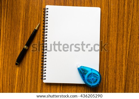 close up opening note paper and pen on wood texture background with copy space - stock photo