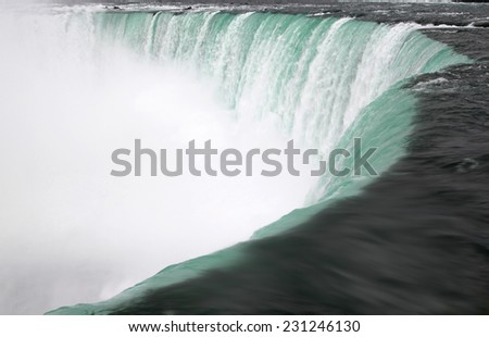 Close up or roaring water rushing over the cliff of Horseshoe Falls in Niagara Falls, Ontario, Canada - stock photo