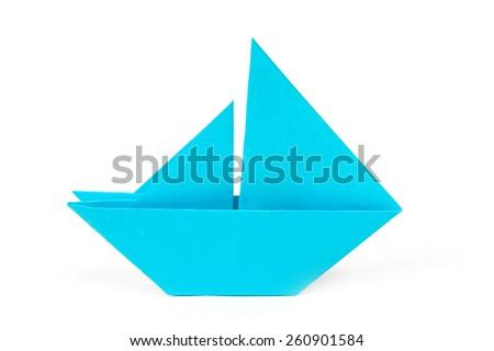 Close up origami ship isolated on white background - stock photo