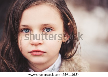 close up outdoor portrait of adorable caucasian child girl - stock photo