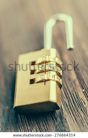 Close up pad lock on wooden background - vintage effect style pictures