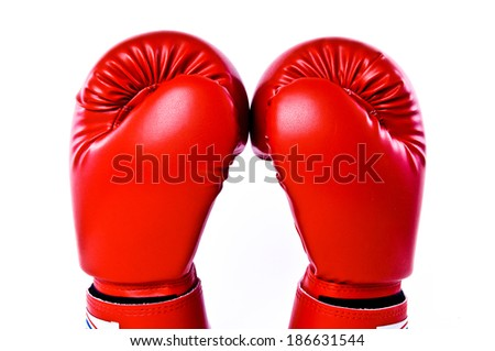 Close up Pair of Boxing Gloves Red Leather Skin Hand Together Isolated on white background. - stock photo