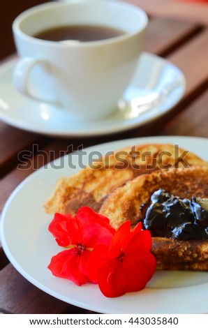 close-up Pancake with marmalade and a cup of tea - stock photo