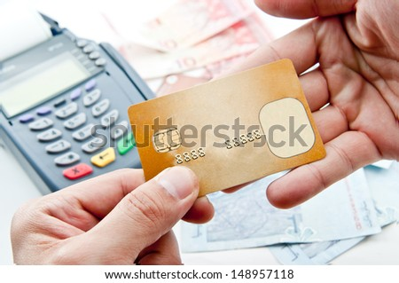 Close up Payment machine on during using Credit card from customer in shopping mall; - stock photo
