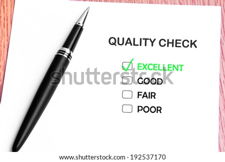 Close Up Pen And List Of Quality Check Checked On Excellent - stock photo