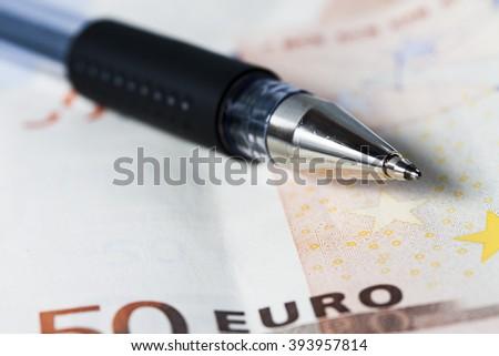 Close-up pen on 50 euro bill.  - stock photo