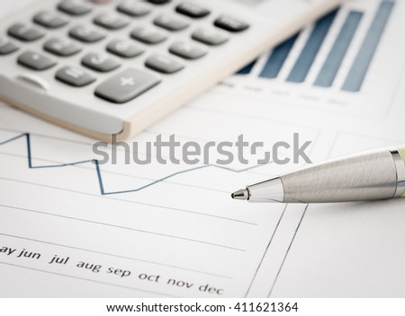 Close-up pen place on the business charts and graphs. Analysis investment business concept. - stock photo