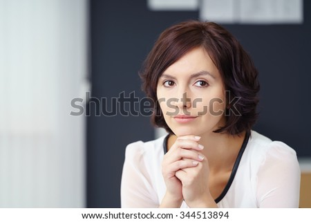 Close up Pensive Young Office Woman Looking Away with her Chin Resting on her Hands. - stock photo