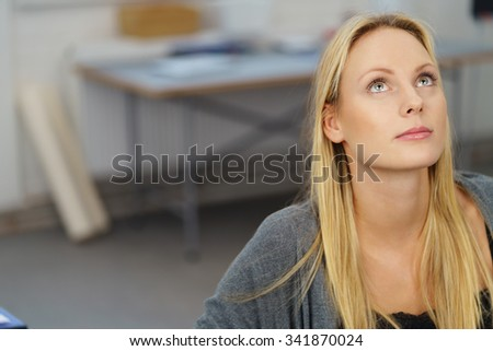 Close up Pensive Young Pretty Businesswoman Looking Up Inside the Office. - stock photo