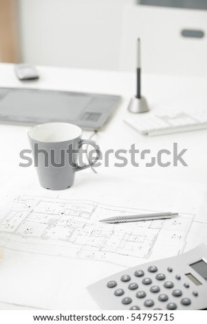 Close-up photo blueprint on office desk. - stock photo