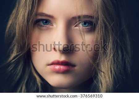 Close up photo from a disappointed young girl - stock photo