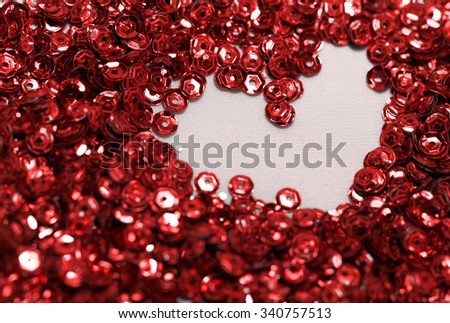 Close up photo lots of red sequin