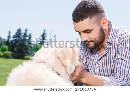 Image result for a man talking to a golden retriever